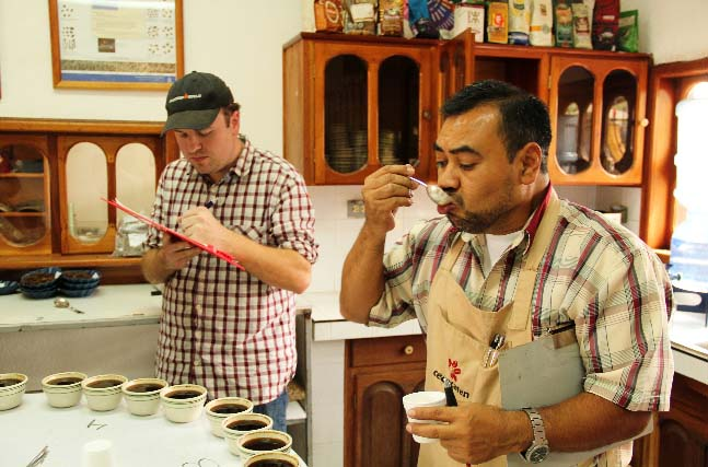 And the final test - Larrys Beans head roaster Brad Brandhorst and SolCafe lead cupper Julio Obregon determine the final composition of their special blend container.