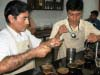 Quality Controller, Alexander Rangel, tests and scores each batch of coffee brought to CENFROCAFE by their members.