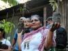 FEM General Director Juanita Villareyna heads towards the fields with coffee seedlings for replanting.
