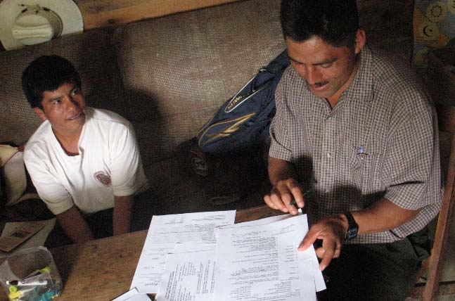 Former President of the Producer Board of Directors, Jose Arias signs contracts during an annual CoopCoffees visit to meet with Maya Vinic farmer members in Acteal.