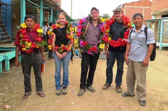 Greeting the CoopCoffees roaster and staff delegation with broad smiles and flower wreaths is a great way to start the day.