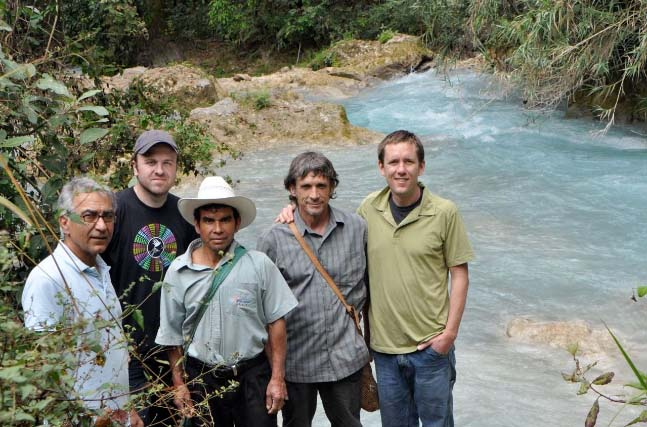 "Roasters enjoy a visit to the river ""Rio Azul\"" from which the coop gets its name."