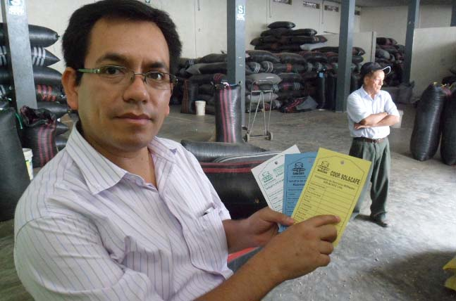 Sol y Cafe General Manager Javier Dominquez shows one step in the long paper-trail associated with direct, fair trade and organic contracts.