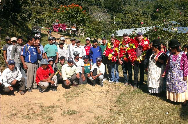 Latin American Green Buyer, Felipe Gurdian and roaster representatives from Larry's Coffee and Peace Coffee are honored with traditional flower wreaths during one of their recent visits to the field.